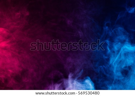 Photo of  colorful smoke on dark background