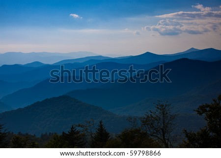 Colorful Smokey mountains with numerous ridges near sunset