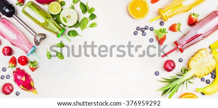 Colorful Smoothie bottles with fresh ingredients and blender on white wooden background, top view, banner. Superfoods and healthy lifestyle or detox  diet food concept.