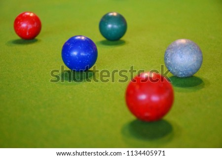 Colorful snooker is placed on the green table, billiard or Cue Sports, It is a kind of sport used in the Olympics. #1134405971