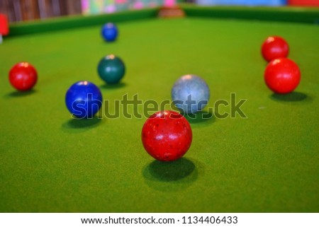 Colorful snooker is placed on the green table, billiard or Cue Sports, It is a kind of sport used in the Olympics. #1134406433