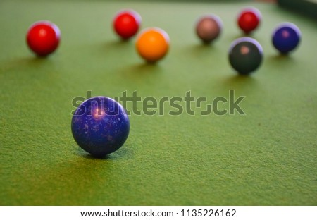 Colorful snooker is placed on the green table, billiard or Cue Sports, It is a kind of sport used in the Olympics. #1135226162
