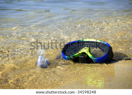 Colorful snorkel on a beautiful golden sand beach