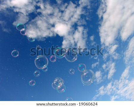 Colorful Soap Bubbles Against Blue Sky Background