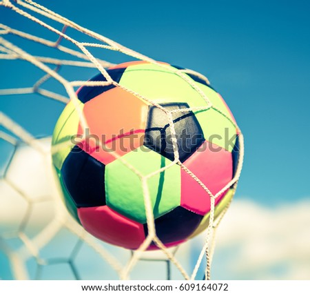 colorful soccer ball in goal net - retro vintage filter effect - Shutterstock ID 609164072