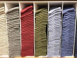 Colorful socks storing in the white shelve, winter socks, warm socks
