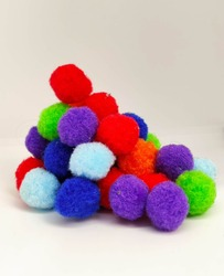 Colorful soft ball on a white background, materials for a handiwork, red, blue and green balls