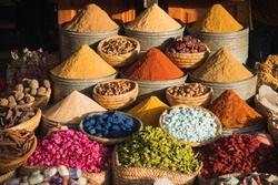 Colorful spices at a traditional market in Marrakech, Morocco