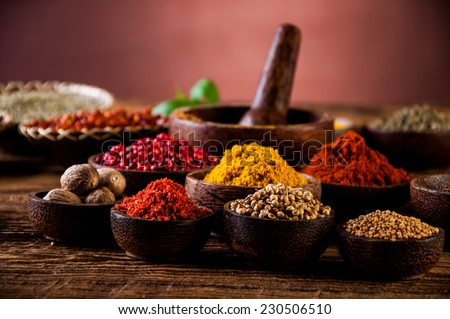 Colorful spices in wooden bowls