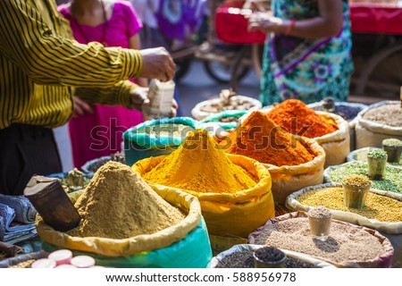Colorful spices powders and herbs in traditional street market in Delhi. India. #588956978