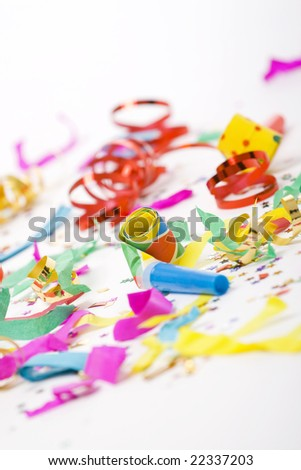 colorful spirals, small confetti stars and colorful blowers on white background, party time