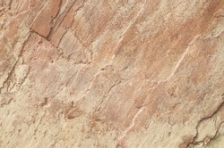 Colorful split sandstone cladding on wall closeup