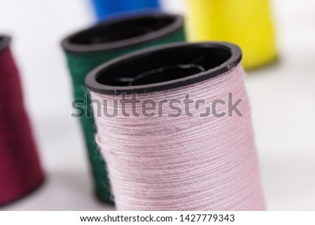 Colorful spools of thread. Accessories for needlework or sewing #1427779343