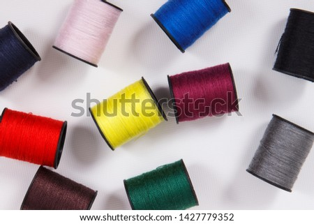 Colorful spools of thread. Accessories for needlework or sewing #1427779352