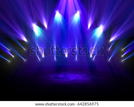 Colorful spotlights shining on a stage #642856975