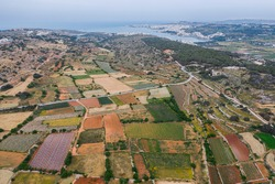 Colorful spring agriculture fields. Nature countryside landscape. Drone point of view. Malta country