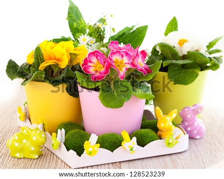 colorful spring flowers with easter decoration