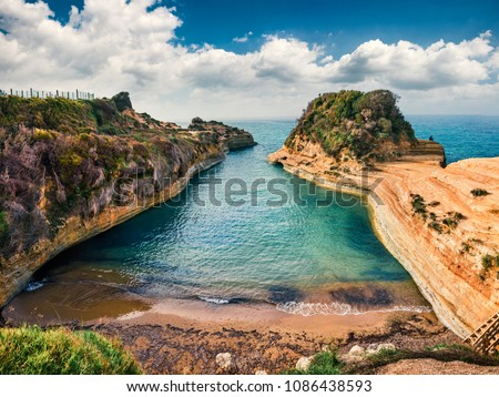 Colorful spring view of famous Channel Of Love (Canal d'Amour) beach. Bright morning seascape of Ionian Sea. Amazing outdoor scene of Corfu Island, Greece, Europe. Beauty of nature concept background