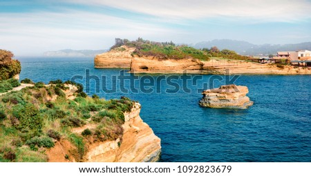 Colorful spring view of Sidari village, famous Channel Of Love (Canal d'Amour) beach location. Bright morning seascape of Ionian Sea. Amazing outdoor scene of Corfu Island, Greece, Europe.