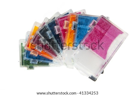 Colorful stack of inkjet printer ink  cartridges empty and ready for recycling arranged in a spiral.