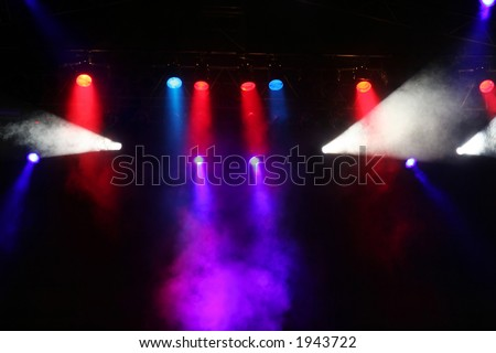 Colorful Stage lights and light rays / beams
