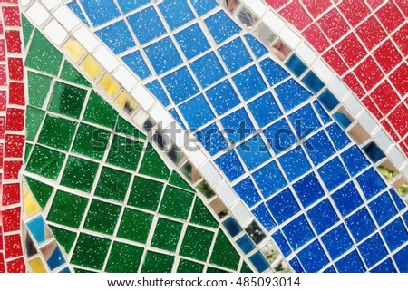 Colorful stained glass window with irregular random block pattern as Mosaic art in Thai temple. #485093014