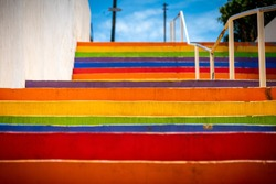 Colorful stairs painted with the colors of the rainbow
