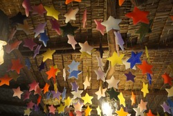 colorful star candles are hanging.