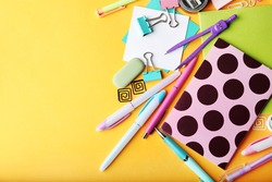 Colorful stationery on yellow background