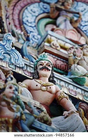 Colorful statue and ornament of Lord Murugan on a Hindu temple wall.