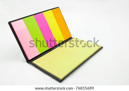 Colorful sticky memo book on white background