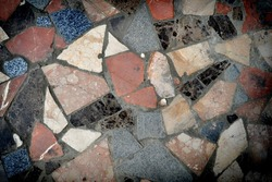 Colorful stone mosaic with chaotic pattern, background photo texture.