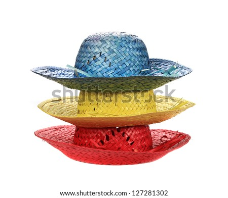 colorful straw hats on white background (cut out)