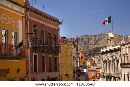 Colorful Street with Mexican Flags, Guanajuato, Mexico, walking down from Plaza of Peace No Trademarks