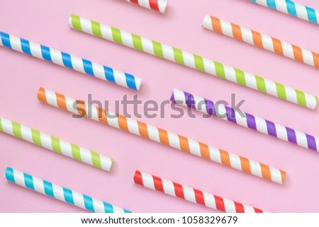Colorful striped drinking straws pattern on pastel pink background minimal creative concept #1058329679