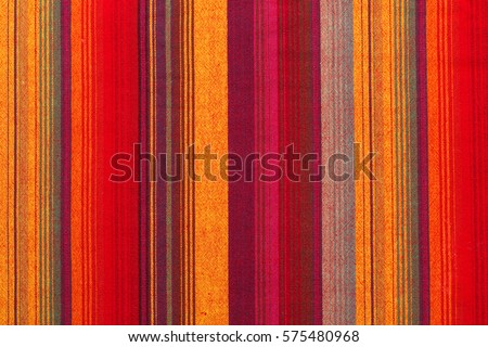Photo of  Colorful striped fabric texture in a close up view