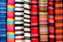 Colorful striped woollen rugs known as  Jarapa, a coarsely woven 'rag rug' sold in villages all over the Alpujurra region in the Sierra Nevada mountains of Andalucia, Spain.