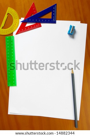 Colorful student gear and blank sheets of paper - stock photo
