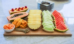 Colorful summer, exotic fruit platter with watermelon, cantaloupe, papaya, mango and tangerines. Healthy Dessert Concept. Selective Focus.