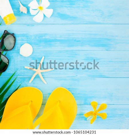 dd1b9f3206897 Colorful summer holiday beach background with accessories on light blue  vintage wood