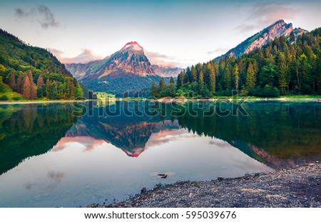Colorful summer landscape on the Obersee lake. Splendid morning view of Swiss Alps, Nafels village location, Switzerland, Europe. Artistic style post processed photo. - Shutterstock ID 595039676