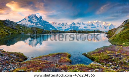 Colorful summer morning on the Lac Blanc lake with Mont Blanc on background, Chamonix location. Beautiful outdoor scene in Vallon de Berard Nature Preserve, Graian Alps, France, Europe.  #476204365