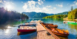 Colorful summer panorama of the Bohinj Lake. Picturesque moning scene in the Triglav National Park, Julian Alps, Slovenia. Popular tourist leisure on the boat. Artistic style post processed photo.