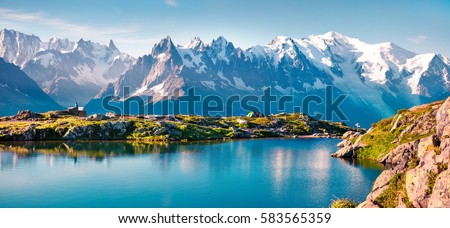 Colorful summer panorama of the Lac Blanc lake with Mont Blanc (Monte Bianco) on background, Chamonix location. Beautiful outdoor scene in Vallon de Berard Nature Reserve, Graian Alps, France, Europe.