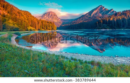 Stock Photo Colorful summer sunrise on the incredibly beautiful Swiss lake Obersee, located near Nafels village. Alps, Switzerland, Europe. Instagram toning.