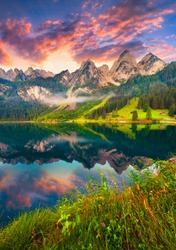 Colorful summer sunrise on the Vorderer Gosausee lake in the Austrian Alps. Austria, Europe.