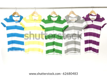 Colorful summer t-shirts on the hanger-close up
