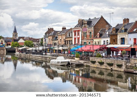Colorful summer verandas of restaurants on the Belu embankment in Amiens, France