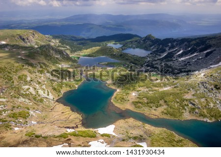 Colorful, sunlit view from the Lakes summit on Rila mountain of The Twin lake, The Trefoil lake, Fish Lake and The Lower lake #1431930434