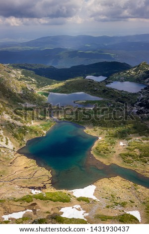 Colorful, sunlit view from the Lakes summit on Rila mountain of The Twin lake, The Trefoil lake, Fish Lake and The Lower lake #1431930437